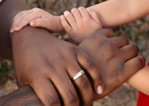 Multi race hands holding each others hands